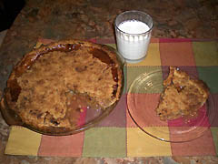 Slice of warm apple pie with glass of milk